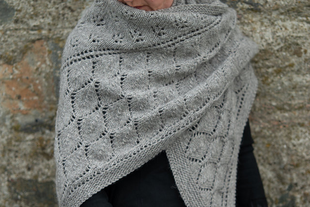 Photo of an adult wearing a grey lace shawl