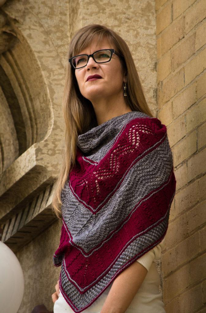 Photo of Sarah wearing purple and grey striped lace shawl